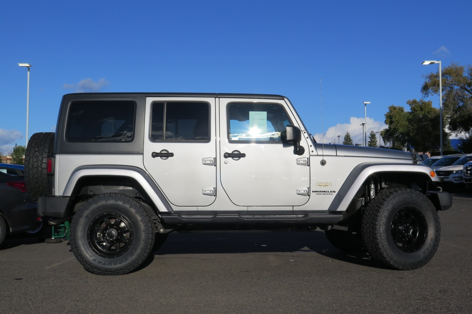 pre-owned 2015 jeep wrangler unlimited sahara 4x4 suv in folsom